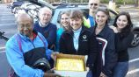 The Bike Alpharetta group posing for the camera with the yummy 501(c)3 celebration cake!