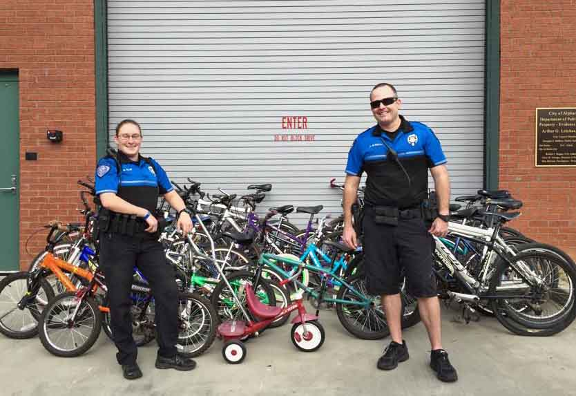 Officers Clay And Elfreth With Bike Donations 2014 Bike